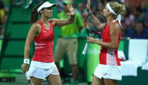 RIO DE JANEIRO, BRAZIL - AUGUST 06: Martina Hingis and Timea Bacsinszky of Switzerland during their first round doubles match against Samantha Stosur and Daria Gavrilova of Australia on Day 1 of the Rio 2016 Olympic Games at the Olympic Tennis Centr...