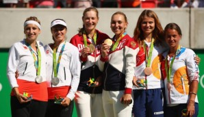 RIO DE JANEIRO, BRAZIL - AUGUST 14: (L-R) Silver medalists Timea Bacsinszky and Martina Hingis of Switzerland, gold medalists Ekaterina Makarova and Elena Vesnina of Russia and bronze medalists Lucie Safarova and Barbora Strycova of the Czech Republ...