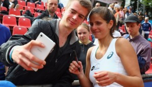 NUREMBERG, GERMANY - MAY 18:  Julia Goerges of Germany takes a selfie with a fan after defeating Yulia Putintseva of Kasakhstan during day five of the Nuernberger Versicherungscup 2016 on May 18, 2016 in Nuremberg, Germany.  (Photo by Alex Grimm/Bong...