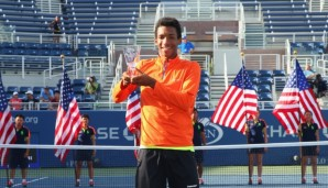 NEW YORK, NY - SEPTEMBER 11:  Felix Auger-Aliassime of Canada celebrates with the trophy after defeating Miomir Kecmanovic of Serbia in their Junior Boys' Doubles match on Day Fourteen of the 2016 US Open at the USTA Billie Jean King National Tennis ...